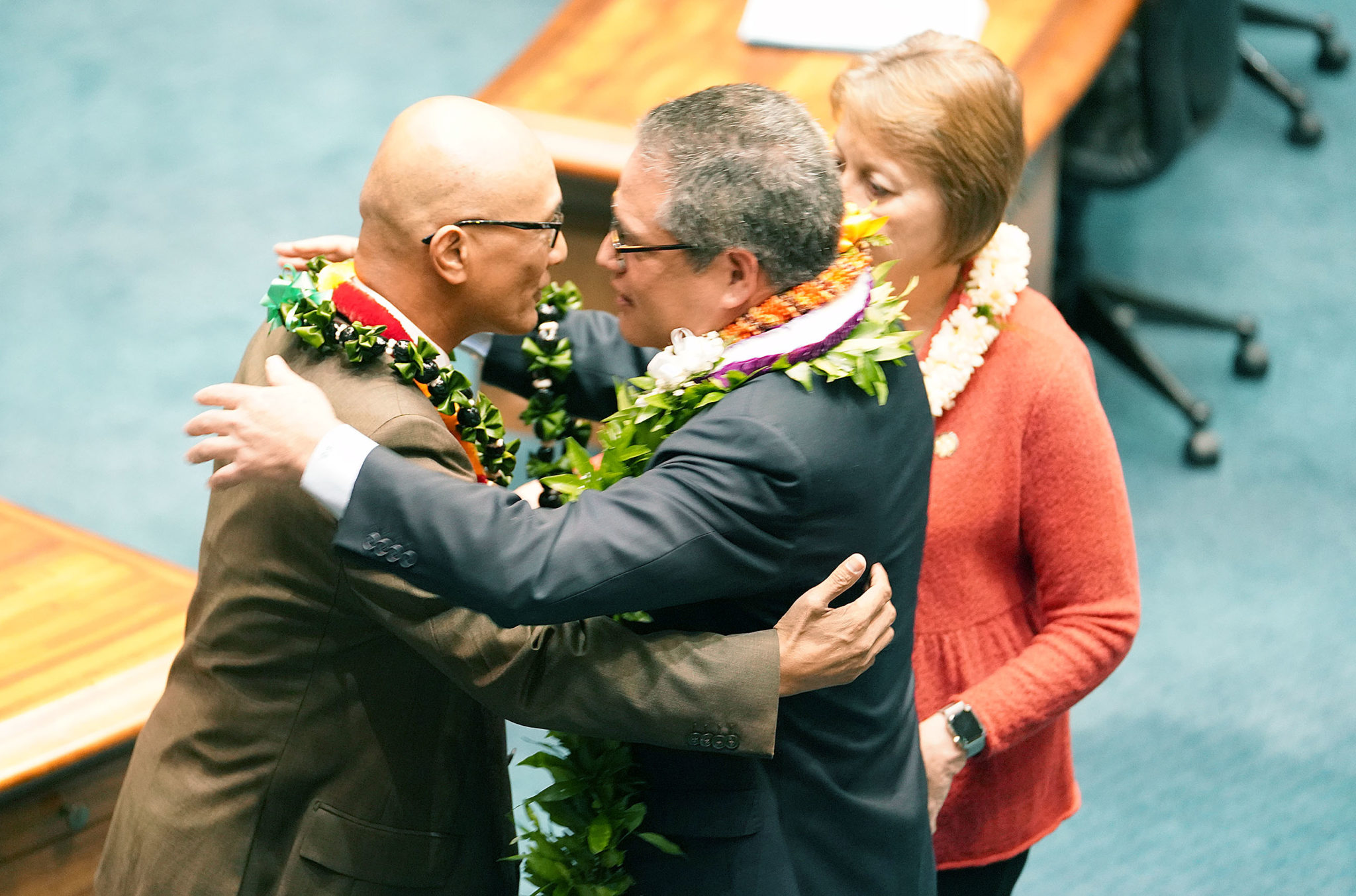 <p>Senate Majority Leader J. Kalani English presents a lei to Sen. Will Espero, left, during a recess. Espero, who represents Ewa Beach, is leaving his post to run for lieutenant governor.</p>