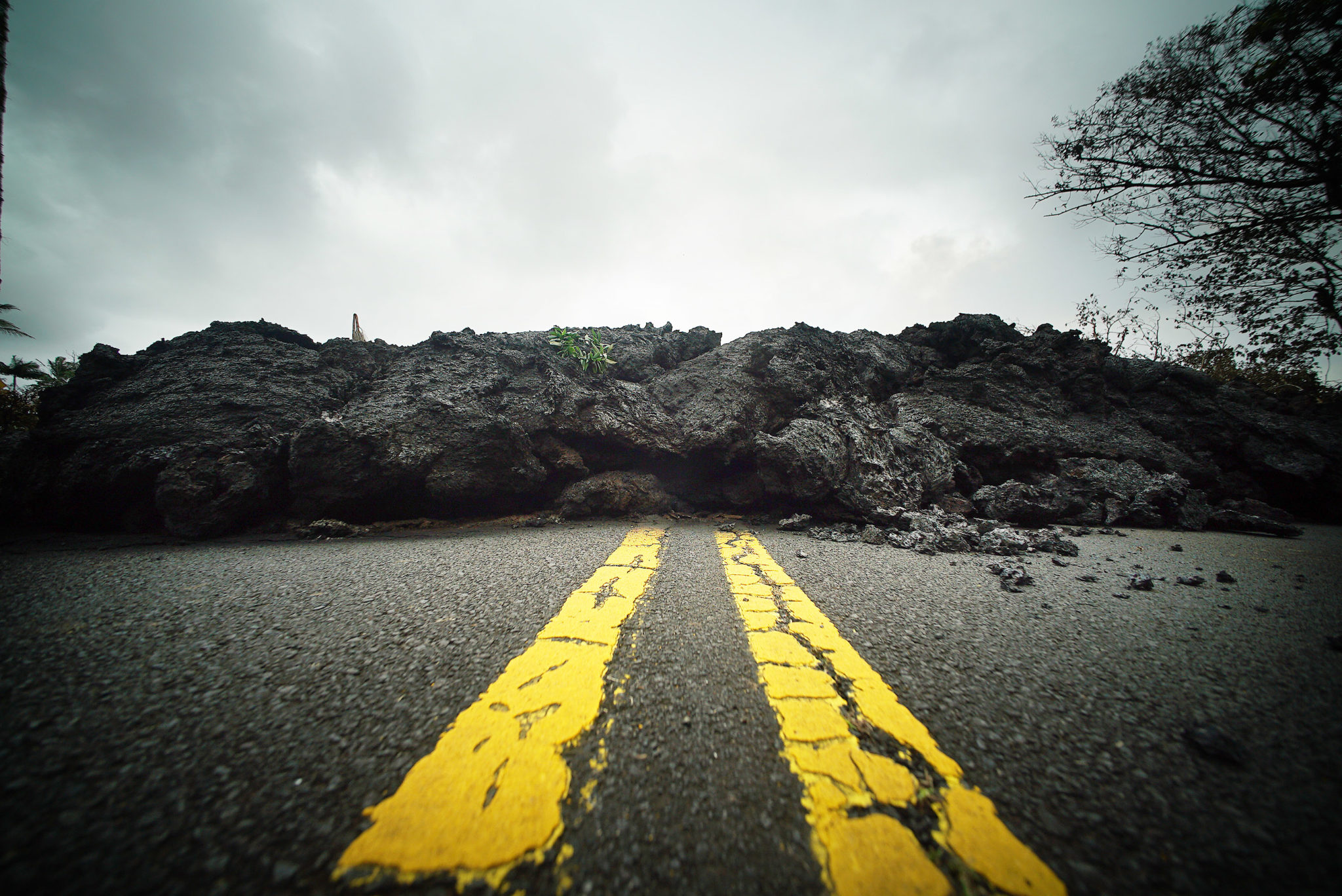 <p>Lava flows cover part of Molala Street in Leilani Estates. At least 36 structures — including 26 homes — have been destroyed by eruptions and lava flows from the Kilauea volcano.</p>