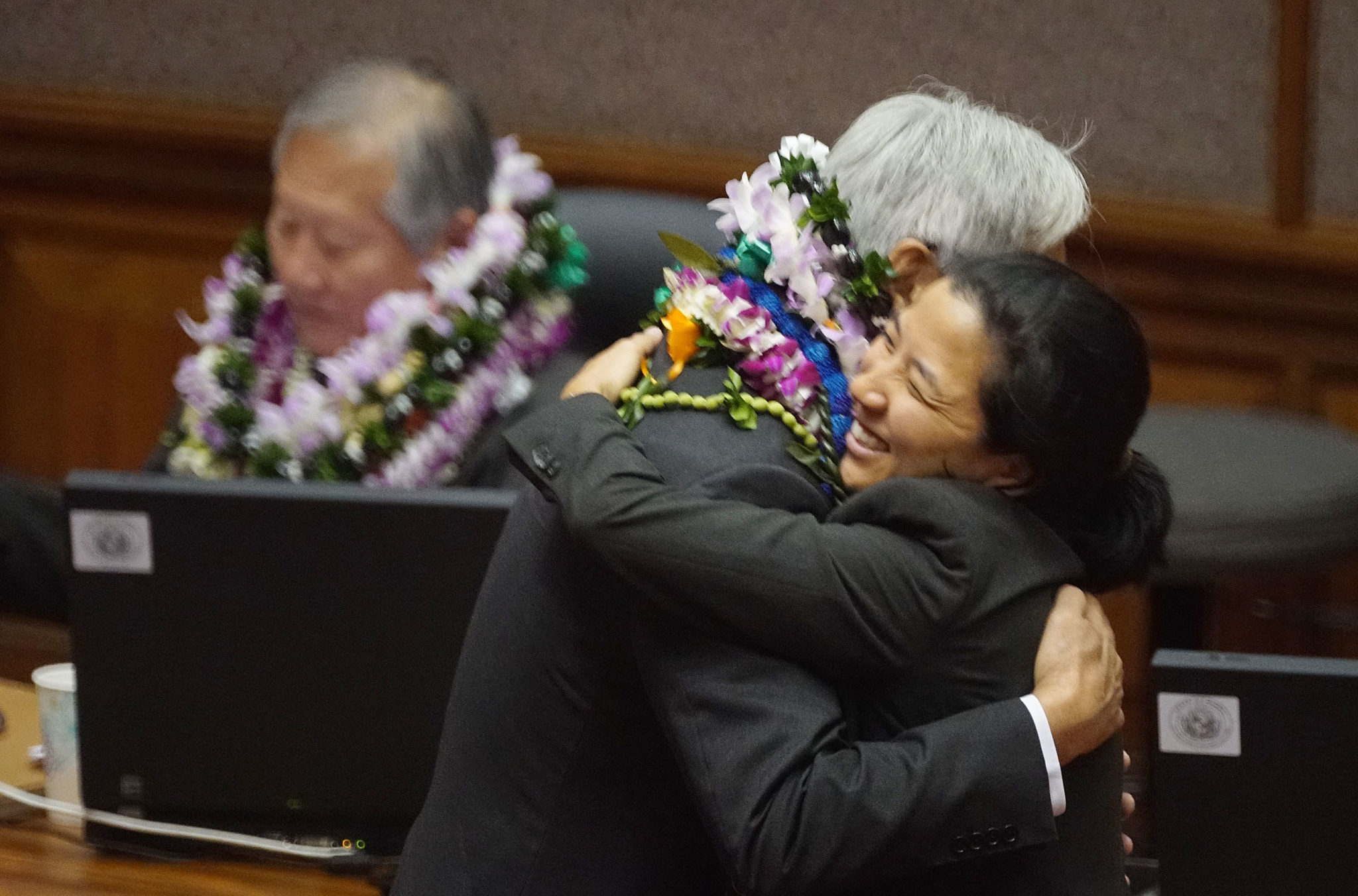 <p>The outgoing Choy, who represents Manoa and Moiliili, gets a goodbye hug from Rep. Linda Ichiyama, who serves Moanalua Valley and Salt Lake.</p>