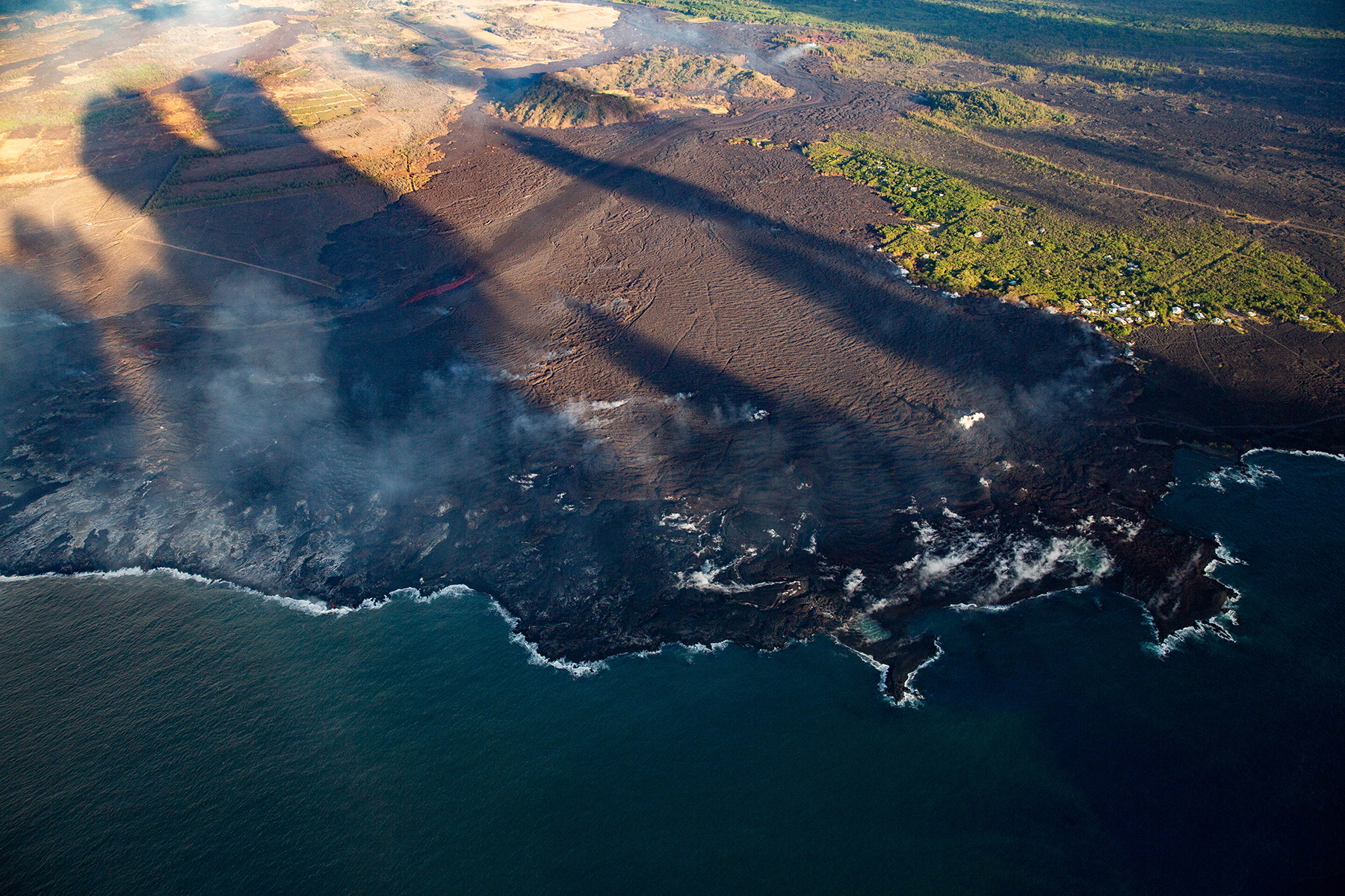 <p>Some of the new land that has formed beyond lava-filled Kapoho Bay.</p>