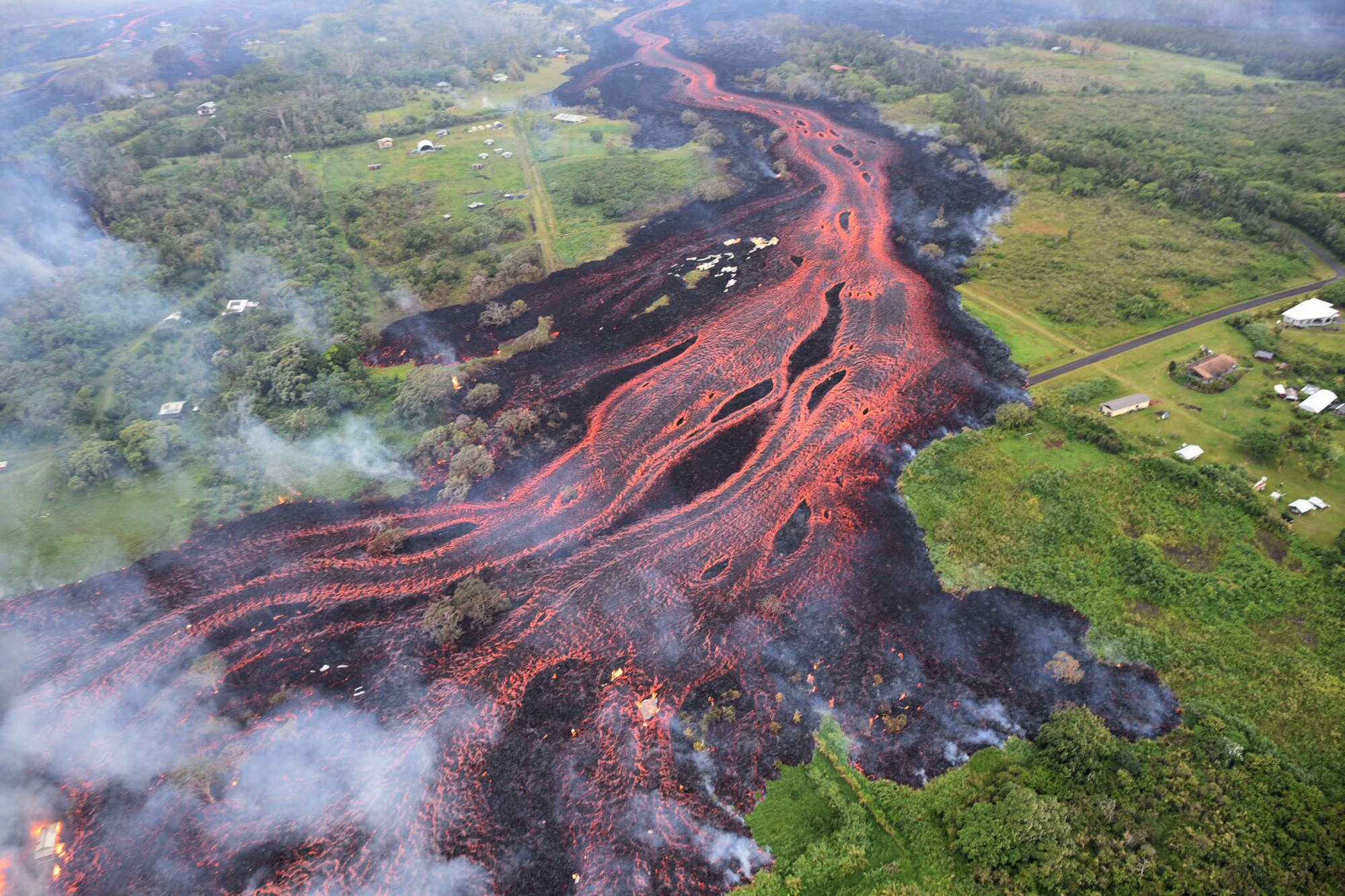 <p><strong>PATH OF DESTRUCTION:</strong> In mid-May, rivers of lava flowed near Pahoa, the gateway to Hawaii Volcanoes National Park. The park reopened in September. / U.S. Geological Survey</p>