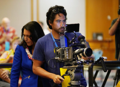 Congresswoman Tulsi Gabbard with husband Abraham Williams as he uses his Arri Amira camera during 2018 Democratic Party convention held at the Hilton Waikaloa Resort. Kona, Hawaii.