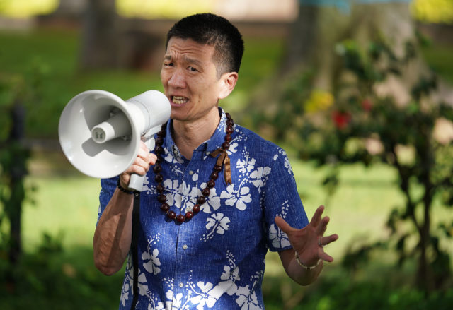 Lieutenant Governor Doug Chin speaks at a rally/demonstration along Ala Moana Boulevard fronting the Federal Building speaking out against Tuesday's 5 to 4 supreme court vote upholding President Trump's travel ban against foreign travelers entering the US.