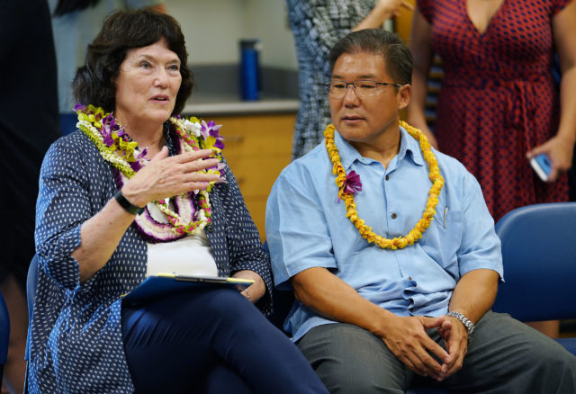 Public sit in a circle during a meet/greet with Board of Education board member Dwight Takeno and left, Chair Catherine Payne at Manoa Library.