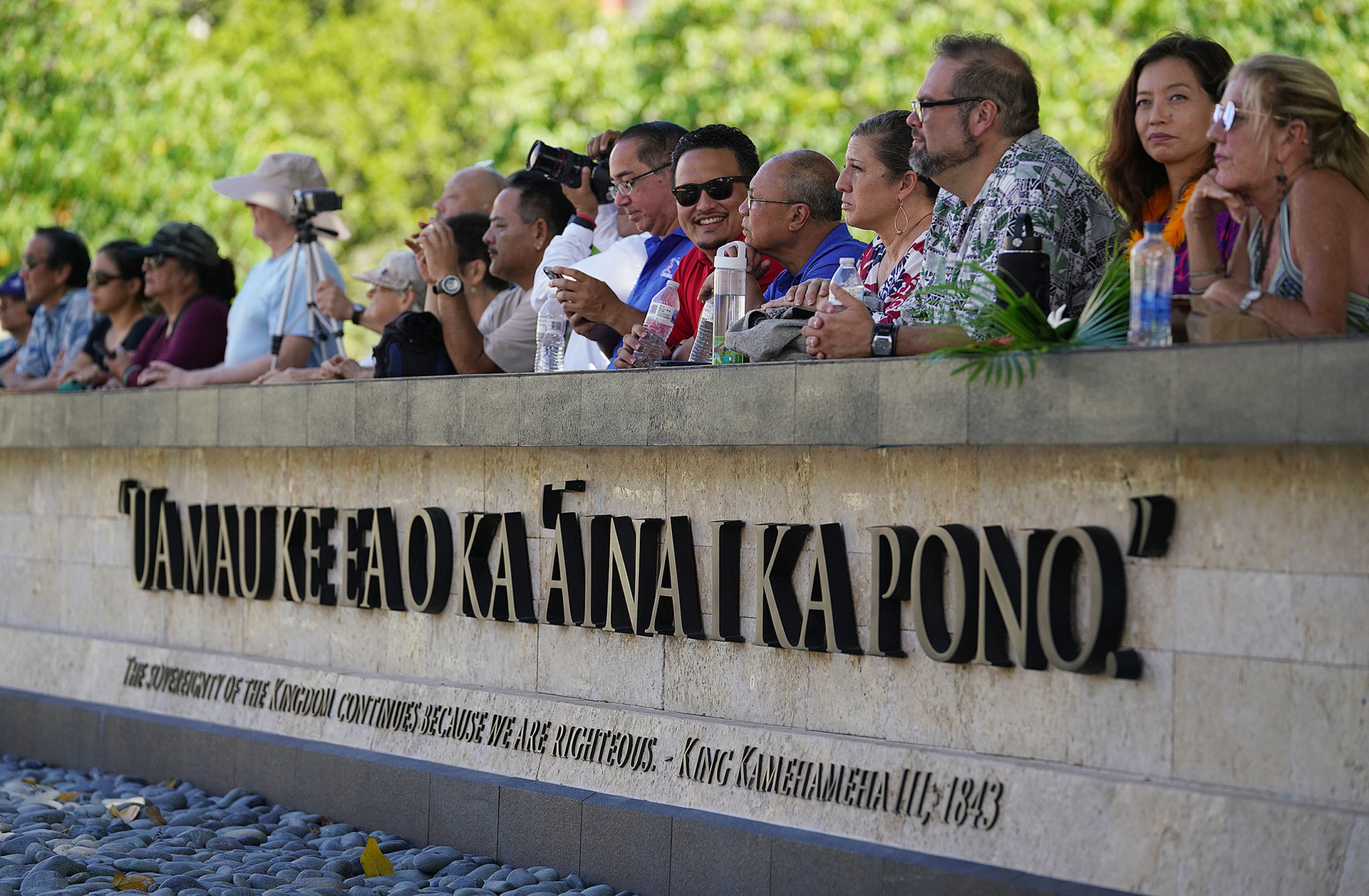 <p>People gather Tuesday at Thomas Square for the dedication of the Kamehameha III sculpture near a a new sign bearing the inscription, &#8220;Ua Mauke Ea o ka ʻĀina i ka Pono&#8221; (&#8220;The sovereignty of the kingdom continues because we are righteous&#8221;).</p>