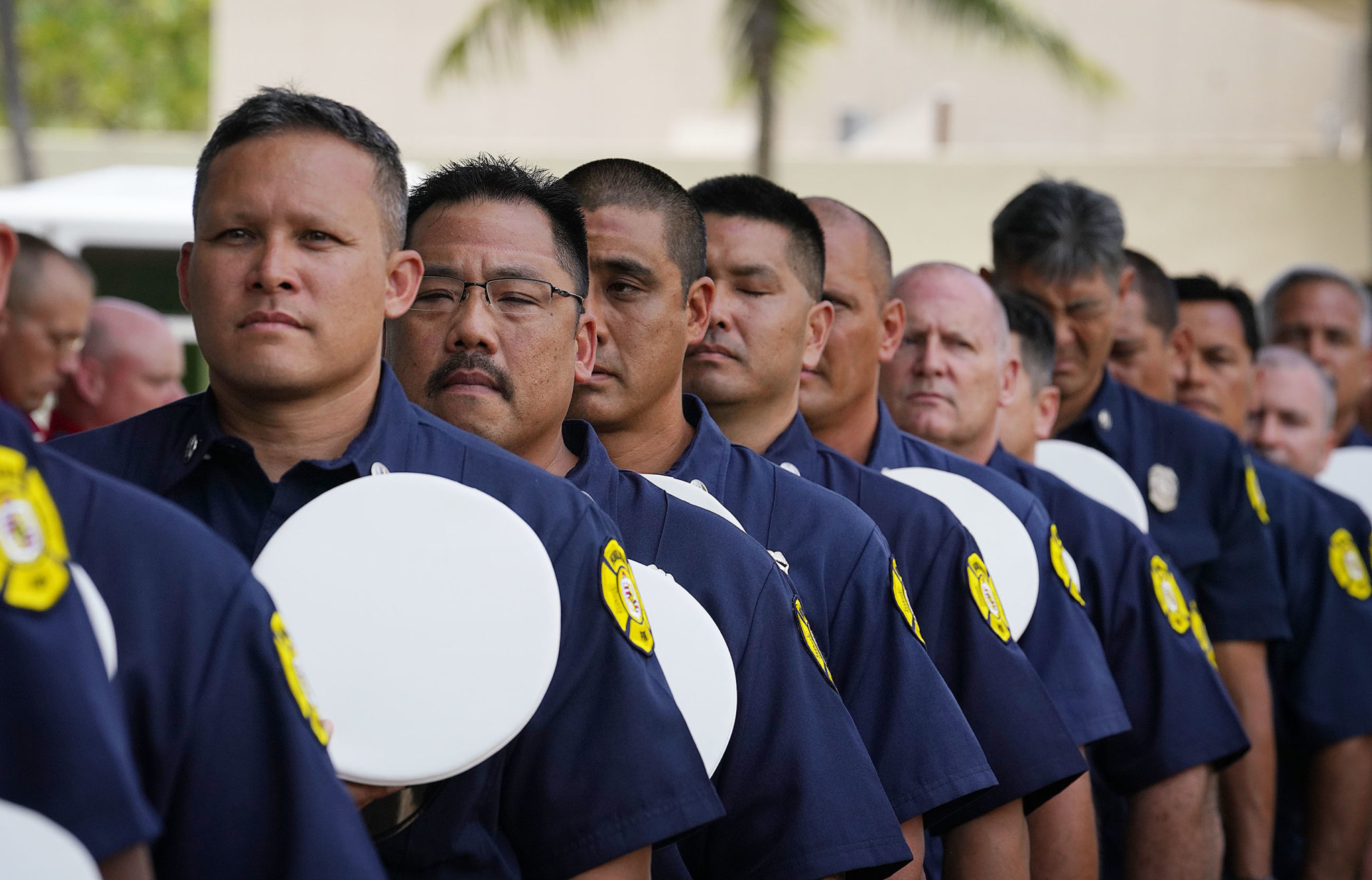 <p>Honolulu firefighters approach the sculpture in a pass-and-review gesture of respect. Kamehameha III founded the fire department in 1850.</p>