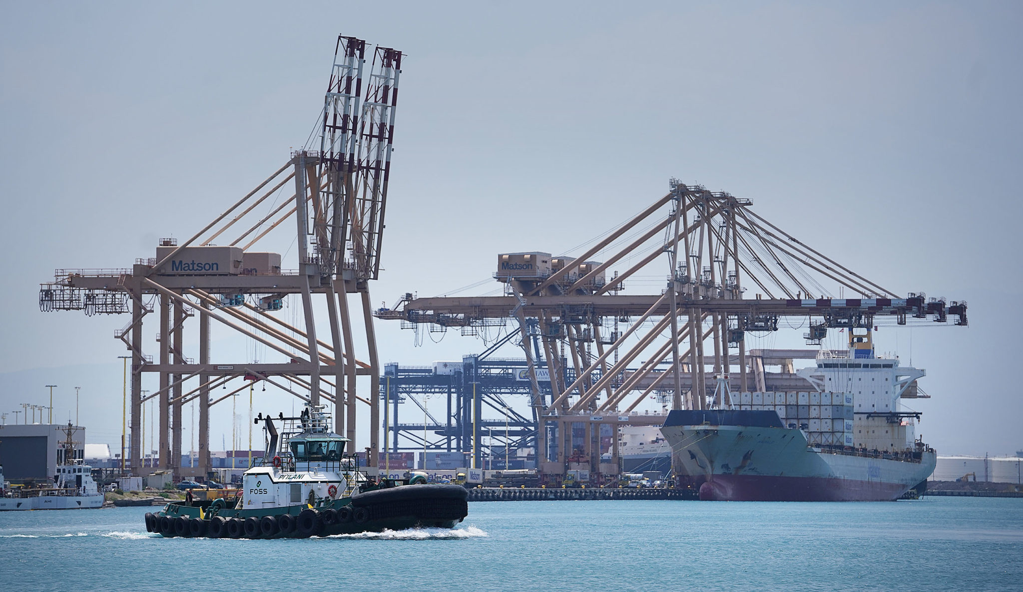 Honolulu Harbor with Matson Container ship and cranes.