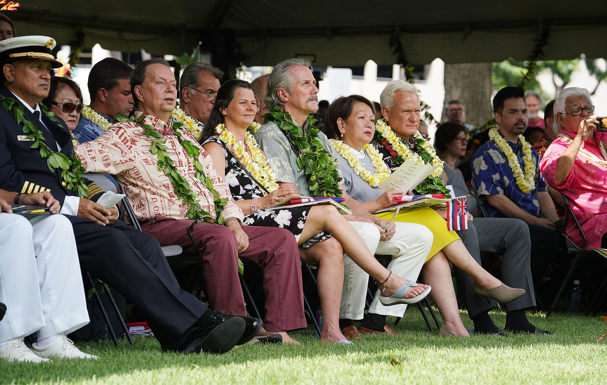 <p>Honolulu Mayor Kirk Caldwell, seated at right front among a group that includes sculptor Thomas Jay Warren, center.</p>