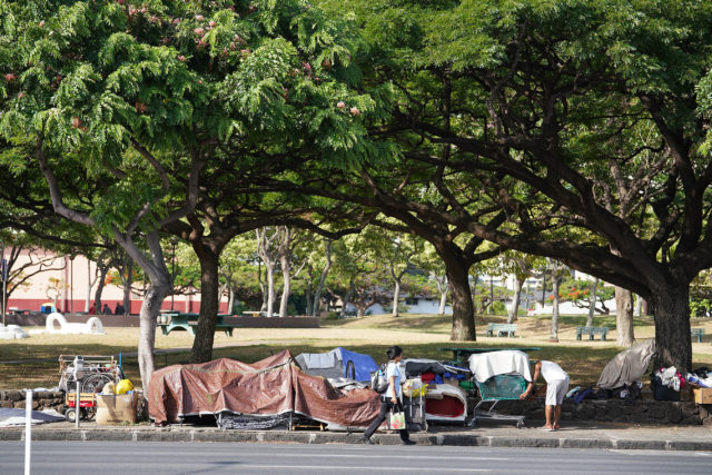 Belongings and tents along South King Street adjacent to the old stadium park after homeless folks near the McCully Library were swept.