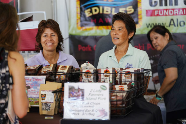 Pig farmers 2 Lady Farmers left, Patsy Oshiro and right Stacy Sugai at their Made in Hawaii booth. Patsy and Stacy raise pigs at their Waianae farm featuring farm to table pigs grown locally.