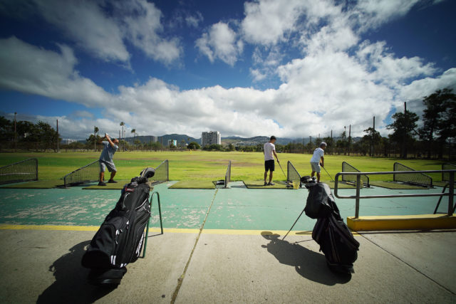 Golfers enjoy hitting some balls at the Ala Wai Driving Range.