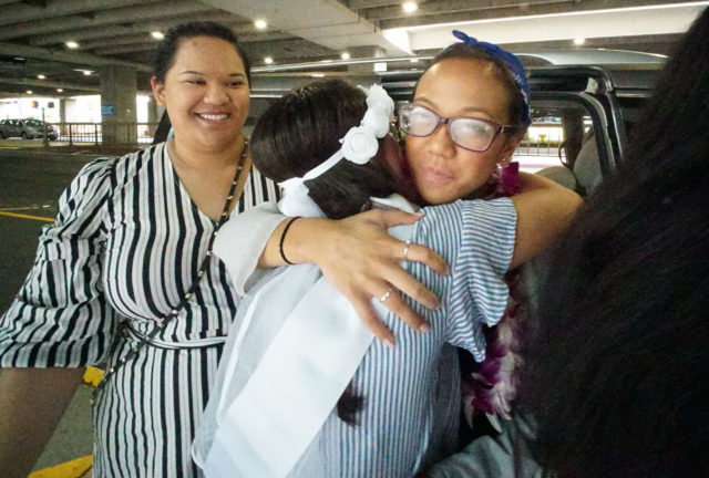 Right, Los Angeles resident Kayla Gangwish hugs bride to be Cheryl Lagmay at the the airport. Gals were in town for a bachelorette party on Oahu, arrived this morning from Los Angeles, CA to Oahu which is under a Hurricane warning.