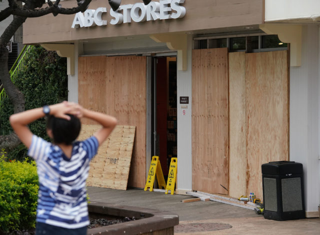 ABC Stores Kalakaua Ave shop boarded in preparation for the arrival of Hurricane Lane.