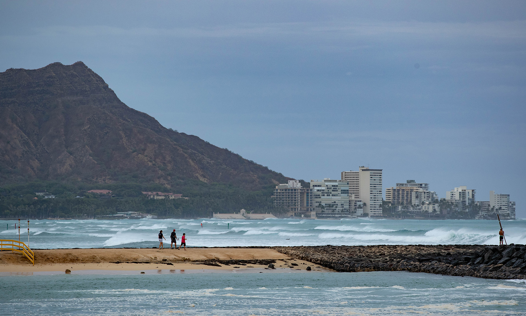 <p>High surf — seen here from Magic Island — remains a danger as the tropical storm passes south of Oahu. Photograph by Anthony Quintano/Civil Beat</p>