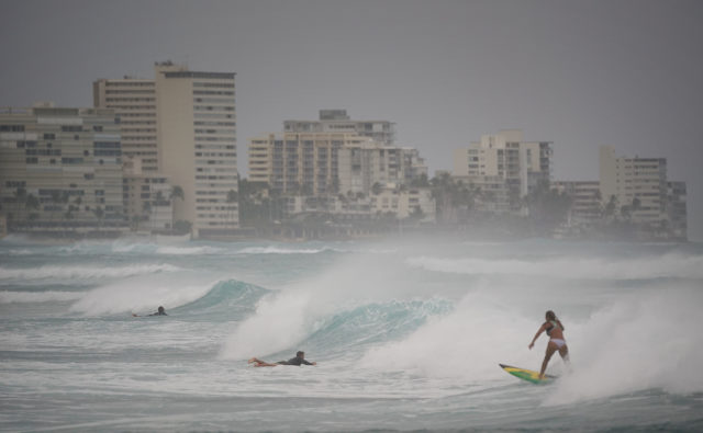 Surfers enjoy swell at Bowls offshore Honolulu as Hurricane Lane approaches.
