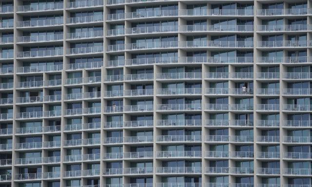 Lone person on lanai at the Ritz Carlton Residences in Waikiki