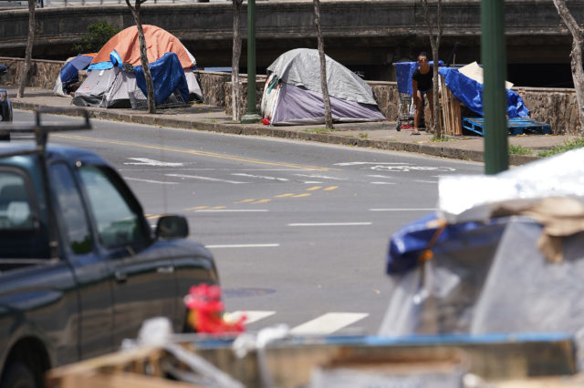 People live in tents along Rivers Street with scores more homeless along Aala Park/King Street.