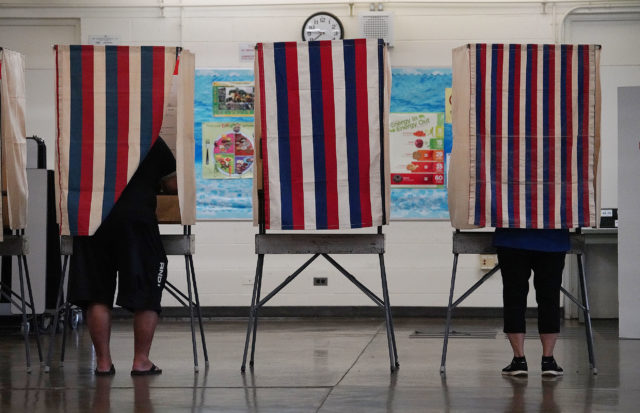 People cast their vote at Benjamin Parker Elementary School cafeteria in Kaneohe. 11 aug 2018