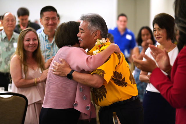 Congresswoman Gubernatorial Candidate Colleen Hanabusa hugs Governor David Ige after her speech at the Democrats Unity Breakfast held at the Dole Cannery Ballroom. 12 aug 2018