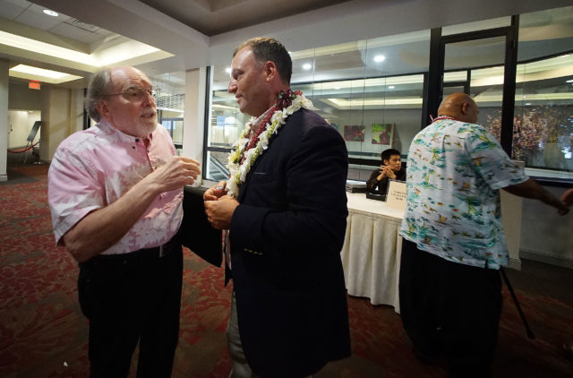 Governor Neil Abercrombie chats with LG Candidate Josh Green before Unity Breakfast held at the Dole Cannery Ballroom.