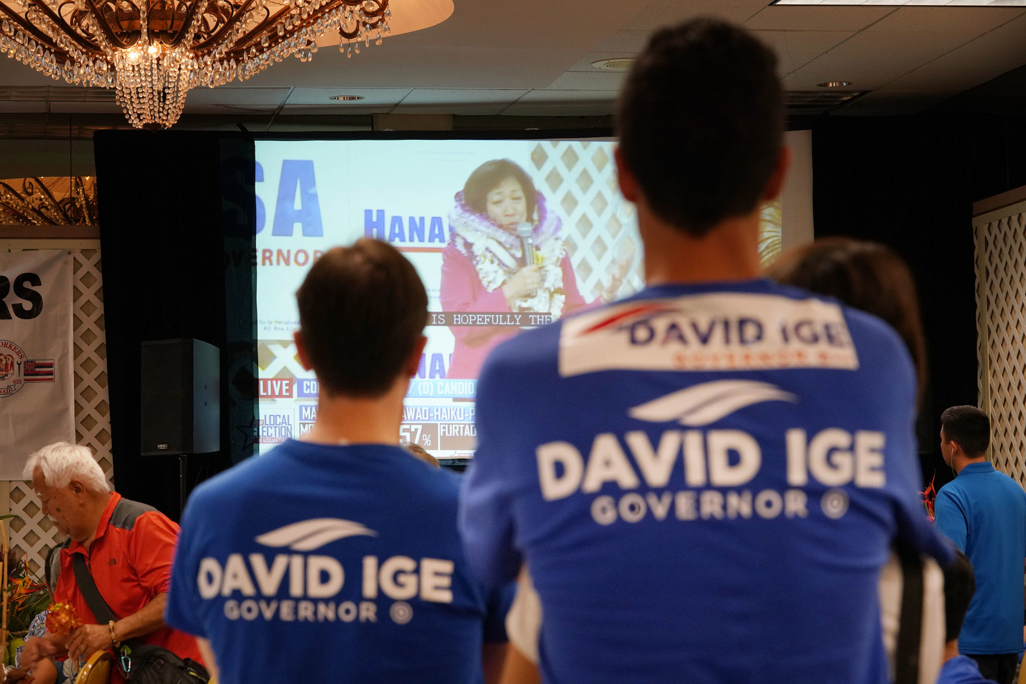 <p>Ige supporters watch the Hanabusa concession speech.</p>