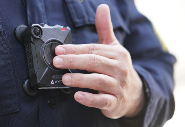 HPD Sgt. Henry Roberts at a HPD press conference announcing 35 officers in downtown are using cameras on a daily basis. Sgt Roberts was sharing that by pressing this button twice, that activated the camera including 30-seconds prior to activating the camera too. 13 aug 2018