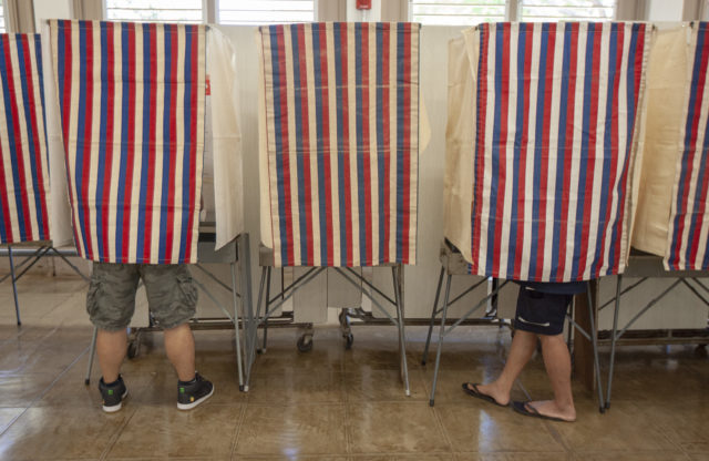 Oahu residents cast their ballot for the primary election at Central Middle School, Saturday, Aug. 11, 2018, in Honolulu.