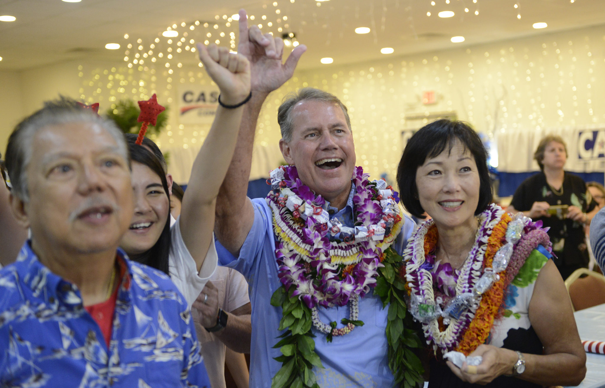<p>Ed Case and his wife, Audrey Nakamura, right, are all smiles as early returns show him pulling ahead of the rest of a crowded field of Democratic candidates for the 1st Congressional District.</p>
