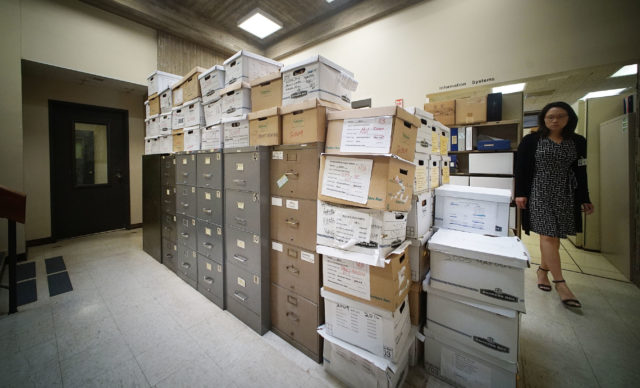 Mountains of boxes with records at Oahu Community Corrections Center OCCC.