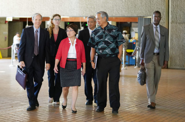 City Corp Counsel Donna Leong walks attorneys District Court following oral arguments regarding complaint filed against proposed constitutional amendment.