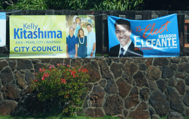 honolulu City Council candidate Kelly Kitashima and Brandon Elefante sign in Pearl City.