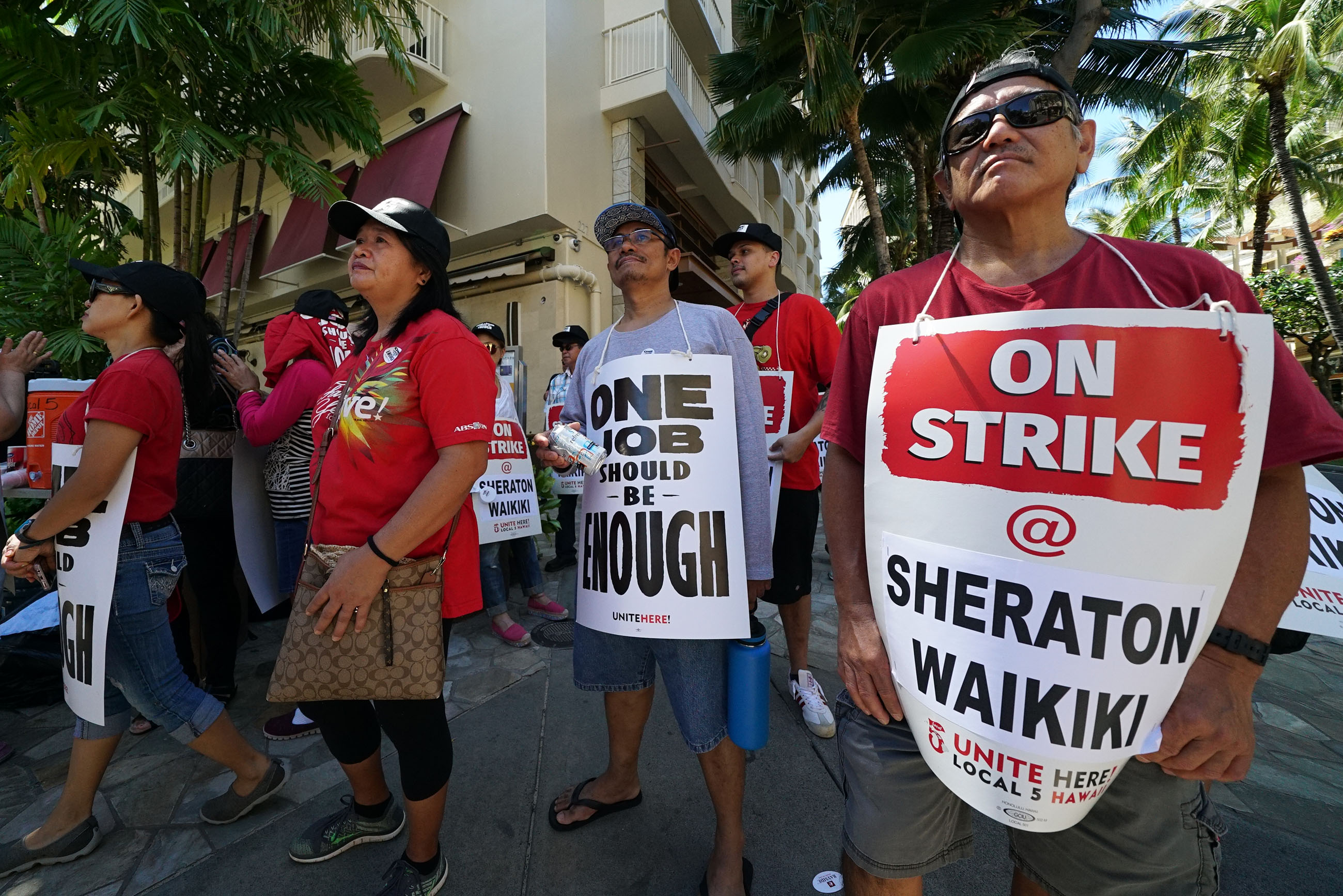 <p><strong>HOTEL PICKETS:</strong> Workers at five Hawaii hotels went on strike in October, resulting in short-term financial hardships for off-the-job employees and Kyo-Ya Hotels, operated by Marriott. Fifty-one days later, they reached a settlement that applies to thousands of hotel workers. / Cory Lum</p>