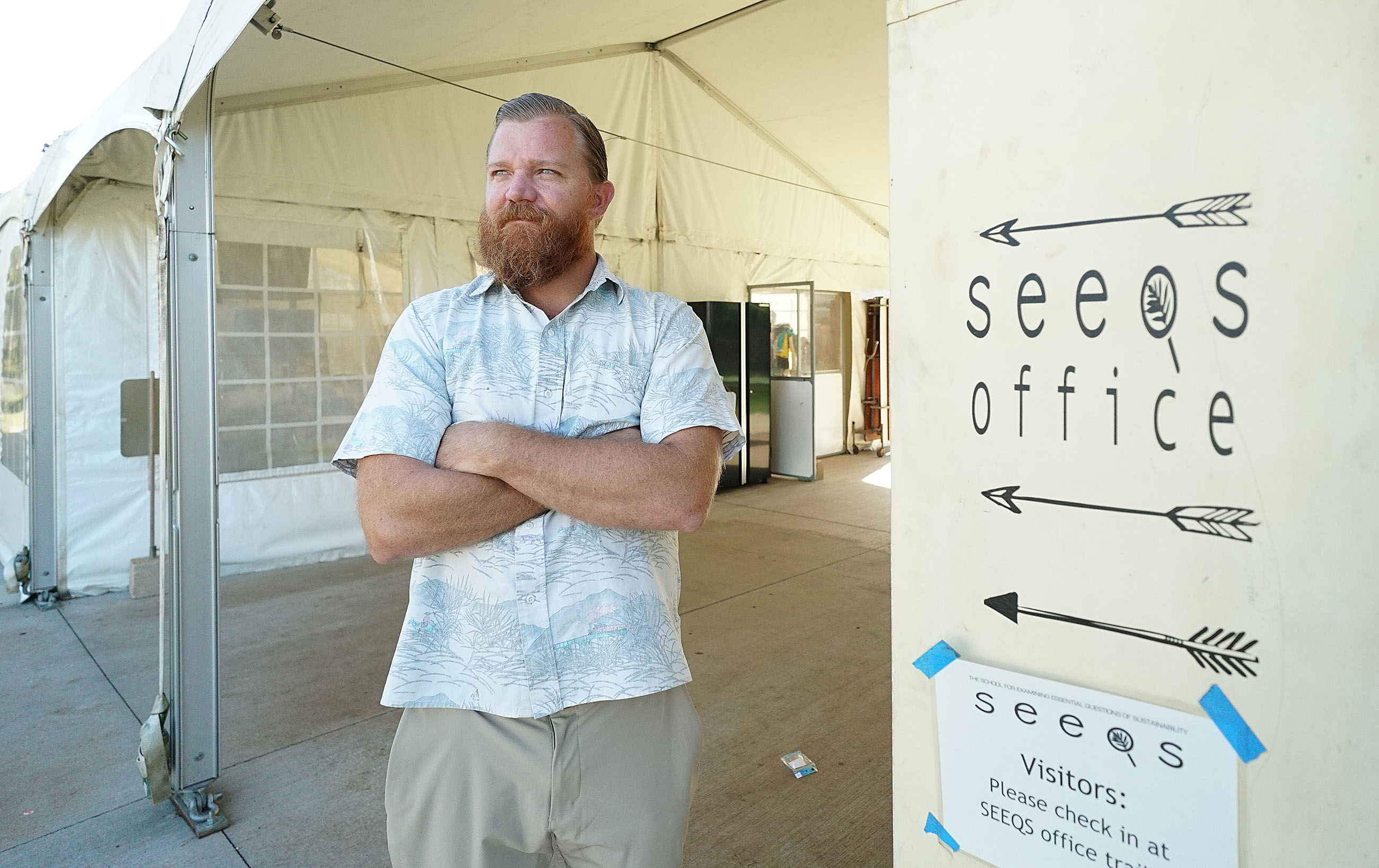 SEEQ Teacher Shane Albritton at Kaimuki High School SEEQ tent in background.