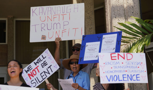 UH Kavanaugh Protest with varioud signs fronting the University of Hawaii at Manoa Student Services building.