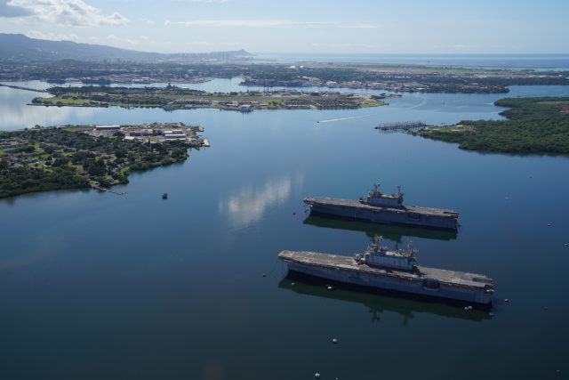 Pearl Harbor Arizona Memorial Ford Island West Loch derelict ships.