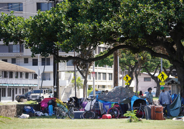 Ala Wai park homeless prepare to move out of park.