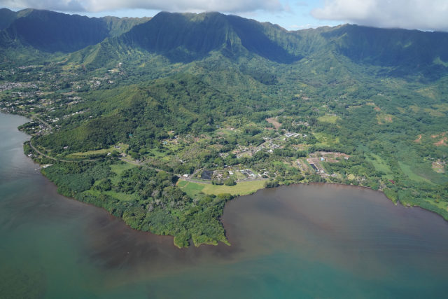 Kaneohe Bay Kahaluu Windward oahu reef aerial with what looks like some soil runoff polution along the shoreline.