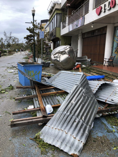 Debris is scattered after Super Typhoon Yutu hit the U.S. Commonwealth of the Northern Mariana Islands, Thursday, Oct. 25, 2018, in Garapan, Saipan. Residents of the U.S. territory braced Thursday for months without electricity or running water after the islands were slammed with the strongest storm to hit any part of the U.S. this year. (AP Photo/Dean Sensui)