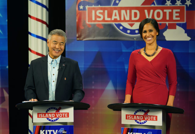 Governor David Ige and challenger Andria Tupuola during a break in the live debate at KITV this evening.