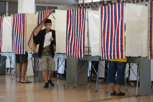 Voters cast their vote at Farrington High School.