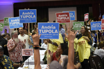 Supporters of republican candidate for Governor Andria Tupola hold signs as support in Honolulu, Hawai'i on Tuesday November 6th, 2018.CB Photo/Ronen Zilberman