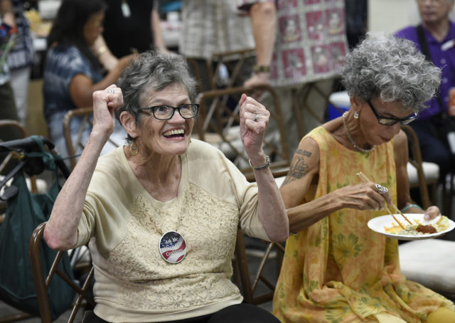 Republican supporter Beverly C Sutton Toomey (left) reacts to the news of the Republicans keeping their hold on the senate at the Honolulu Republican Party Headquarters on Tuesday, Nov. 6, 2018. (Photo by Ronen Zilberman