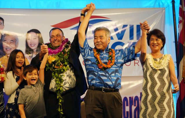 LG elect Josh Green w/ son, 6-year old Sam Green, daughter 10-year-old Maia Green celebrate with Gov Ige and First Lady Dawn Ige on stage at the Dole Cannery Ballroom.