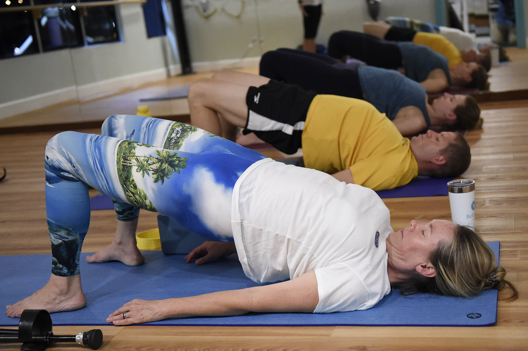 US veterans stretch during a yoga class created just for them called Warriors At Ease at the Bella Kai Yoga Studio in Kailua, Wednesday, November 7, 2018. (Civil Beat photo Ronen Zilberman)