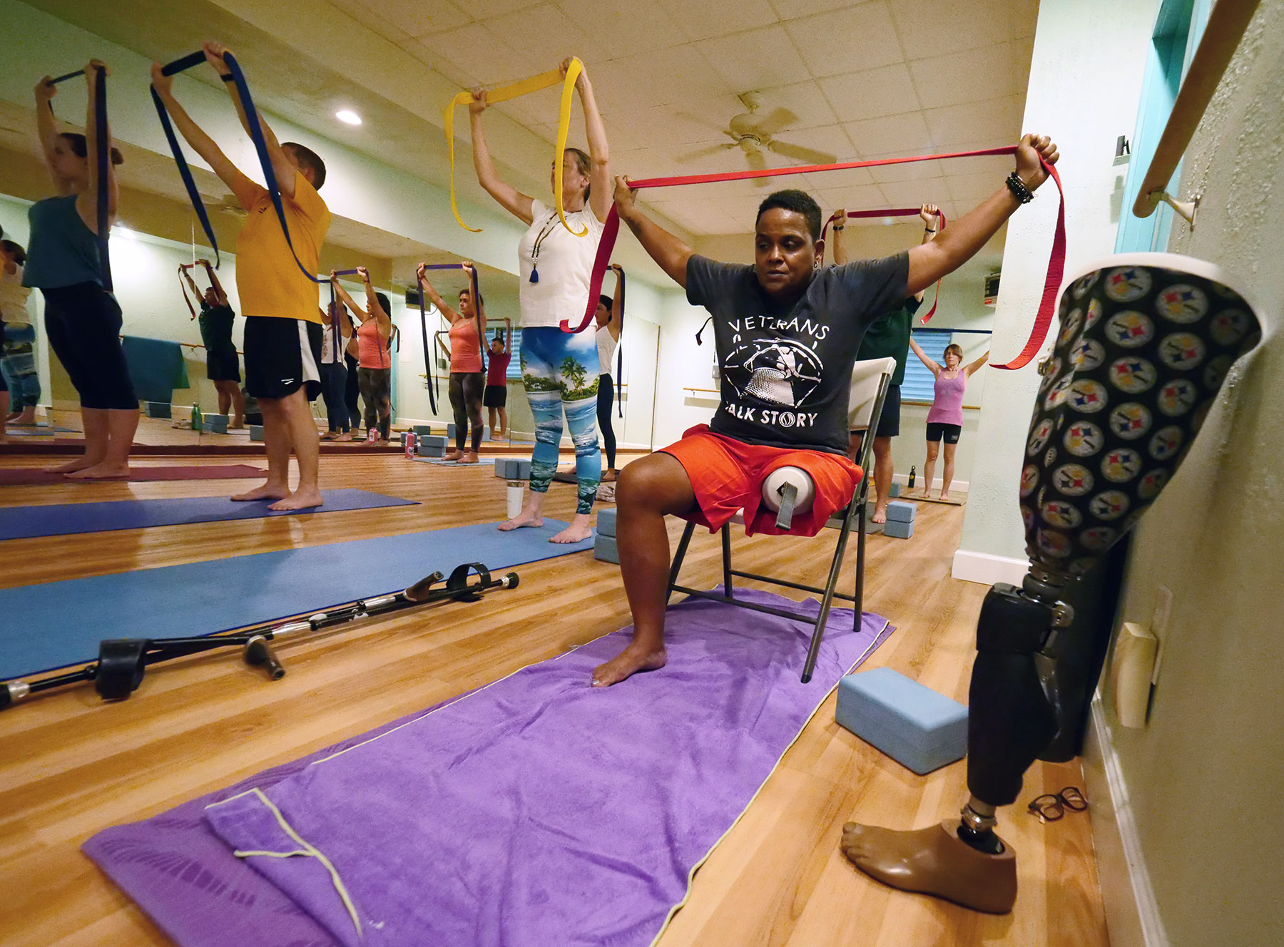 US veteran Cyndi Lee sits as she stretches during a yoga class designed specifically for veterans called Warriors At Ease at the Bella Kai Yoga Studio in Kailua, Wednesday, November 7, 2018. (Civil Beat photo Ronen Zilberman)