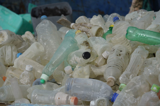 Papahanaumokuakea cleanup sorting plastic beverage bottles. Almost 3000 bottles collected annually.