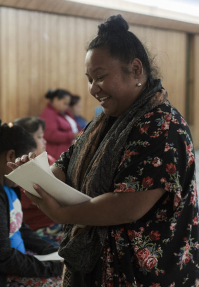Melisa Laelan hands out a survey to Marshallese women during a women's meeting to discuss credit and budgeting at the First Marshallese Full Gospel Church in Springdale, Wednesday, October 18, 2018
