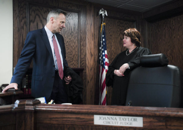 Judge Doug Martin and Judge Joanna Taylor (from left) converse in Judge Taylor's court room at the Washington County Courthouse in Fayetteville, Friday, October 5, 2018.