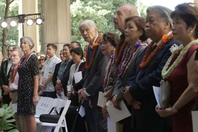 On far left, former Governors Neil Abercrombie and Linda Lingle look on while former Gov. George Ariyoshi and wife Jean Ariyoshi, former Gov. John Waihee and wife Lynne Waihee, and former Gov. Ben Cayetano and wife Vicky Cayetano also look on during the inauguration ceremony of current Gov. David Ige at the state capitol in Honolulu, HI, Monday, December 3, 2018. (Civil Beat photo Ronen Zilberman)
