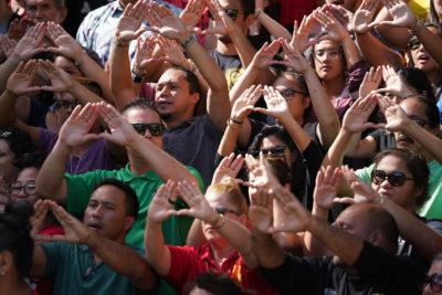 Scores of demonstrators rally against telescope construction on Mauna Kea on the steps of UH Manoa's Hawaii Hall.